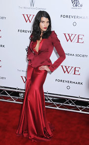 Crystal Renn looked divine in a lustrous red mermaid gown at the 'W.E.' NYC premiere.
