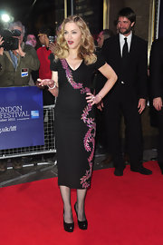 At the 'W.E.' premiere in London, Madonna paired her chic cocktail dress with black platform pumps.