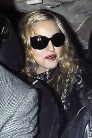 Madonna shielded her gaze from the paparazzi in a pair of black oval sunglasses.