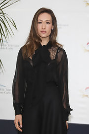 Maggie Q looked conservative yet classy in a black lace tie-neck blouse at the 'Nikita' photocall in Monte Carlo.