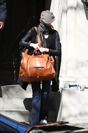 Maggie Grace carried this over-sized leather tote while leaving NYC.