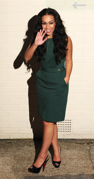 Rebecca Ferguson sported this simple yet flawless ensemble, consisting of black Christian Louboutin platform peep-toes and a green dress, during an episode of 'The X Factor.'