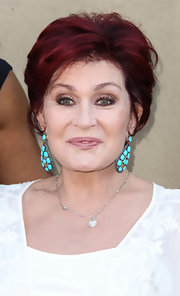 Sharon Osbourne wore a pair of turquoise earrings at a summer party.