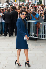 Farida looked classic and sophisticated in a blue evening coat that featured black lapels.