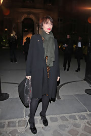 Kristin Scott Thomas donned black patent strappy platforms to the Yves Saint Laurent show.