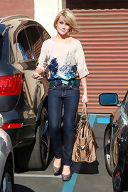 Chelsea Kane looked ultra-girly in a cream blouse with an abstract floral print.