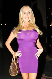 Adult star Mary Carey was all smiles while sneaking a photo with the paparazzi. She wore a hip-hugging bandage dress accompanied by a bowler bag.