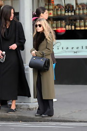 Mary-Kate Olsen looked as stylish as ever in a long olive coat with fur trim.