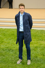 Greg James wore a long raincoat for a practical but still stylish look.