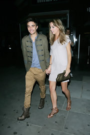 Booy bander Tom Parker stayed on trend in this olive military jacket, while out with a lady friend in London.