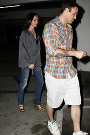 Megan Fox paired a silky loose-fitting blouse with skinny jeans and cool animal print wedges while out and Hollywood.