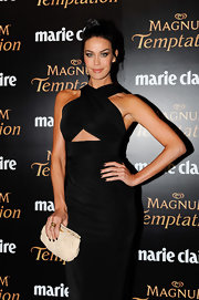 Megan Gale complemented her sexy LBD with a ruched nude leather clutch when she attended the 2011 Prix de Marie Claire Awards.