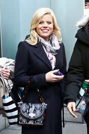 Megan Hilty rocked a snakeskin and chain tote bag while filming 'Smash' in NYC.