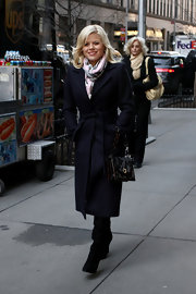 Megan Hilty beat the winter breeze in style with a belted wool coat on the set of 'Smash.'
