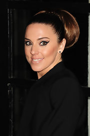 Melanie showed off her voluminous bun while attending the Evening Standard Theater Awards.
