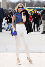Elena Perminova showed off her edgy fashion with these high-waisted pants and adorable crop top.