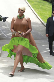 NeNe Leakes wore this brown halter dress that featured a bright grass green ruffled fishtail skirt.