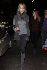 Melanie Griffith bundled up outside the Sting concert in a gray long-sleeve tee and a matching vest with fur trim.