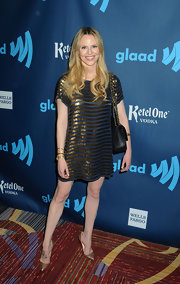 Rosie Pope opted for a gold striped dress for her mod-inspired red carpet look at the GLAAD Media Awards.