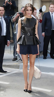 Olivia looked classy at the Dior Couture show in Paris wearing these crisp blue shorts and leather top.