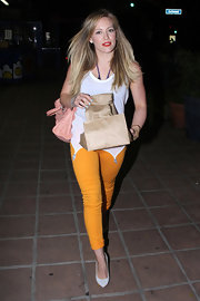 Hilary went for bold colors in a pair of yellow skinny jeans a red lips.