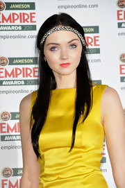 Lily Cole loaded up on the brights with this orange lipstick and yellow dress combo at the 2011 Jameson Empire Awards.