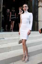 Emma stunned in a sleek white one-sleeved dress with a high turtleneck.