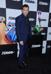 Ryan Reynolds opted for dark colors for the 'Turbo' premiere when he wore this dark blue suit over a navy button down.