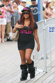 """Snooki"" stepped out in a Hustler t-shirt dress with a Gucci shoulder bag and fuzzy, knee-high boots."