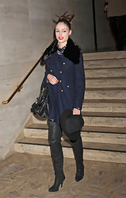 Coco Rocha added drama to her look with over-the-knee leather boots.