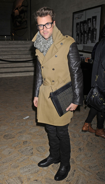 Brad accessorized his look with a leather document holder complete with rocker-chic studded detailing.