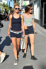 Michelle rocked a pair of navy short shorts for a shopping trip.