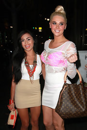 Karissa Shannon looked daring in a little white dress with a see-through lace bodice during a night out at Katsuya.