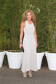 Kelly Hoppen wore a sleeveless gray dress with a drop waist and a flowing skirt.
