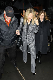 Michelle Pfeiffer went all neutral with this gray slacks, black top, and patterned coat combo on the 'Today' show.