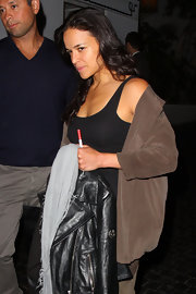 Michelle Rodriguez covered up with an oversized brown button-down as she left Chateau Marmont.