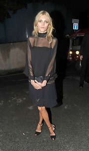 Anja Rubik completed her classic look with a pair of black ankle-strap peep-toes.