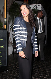 Michelle Rodriguez was spotted at Chateau Marmont wearing a blue and white striped leather jacket over an evening dress.