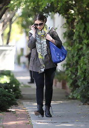 Michelle Trachtenberg kept her street style slightly grungy in an olive cargo jacket.