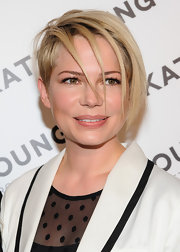 Michelle Williams looked cool and contemporary with her hair styled into this razored 'do.
