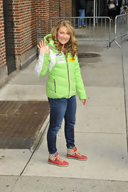 Mikaela Shiffrin was ready for the elements with this lime green down jacket.
