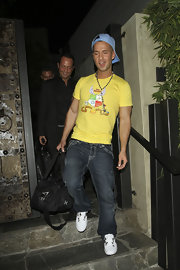 Mike matches the vibrancy of his yellow tee with a baby blue baseball cap out in Hollywood.