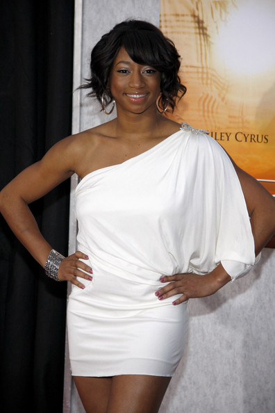Monique Coleman worked the red carpet in a grecian inspired one-shouldered dress. She highlighted her neckline by pinning her soft ringlets up in a loose tousled bun.