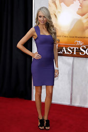 "Melissa Ordway went ultra sexy to ""The Last Song"" premiere. Her purple bandage dress worked great with her pleated ruffled heels."