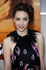 Brittany Curran pinned her brunette ringlets up in a fancy twisted bun. Wearing her hair up was a great way to show off her feathered neckline.