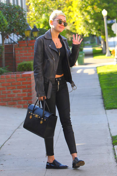 Miley Cyrus in a Leather Jacket