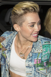 Miley Cyrus sported layers of gold pendant necklaces while enjoying a day out in London.