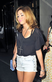 Miley Cyrus accessorized with an oversized cross pendant by Low Luv x Erin Wasson while out and about in New York City.