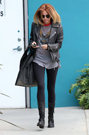 Miley Cyrus stepped into a causal pair of tall black lace-ups after taking a Pilates class in LA.
