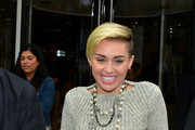 Miley Cyrus meets her fans as she leaves the NRJ Radio studios in Paris.